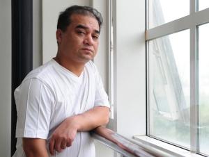 Il blogger e professore uiguro Ilham Tohti. Foto di Frederic J. Brown per Afp